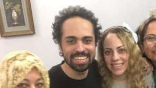 Shadi Abu Zeid (centre) with his family