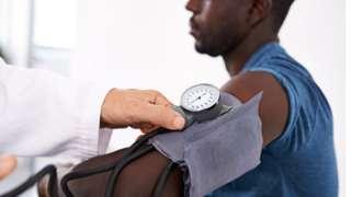 young black man having blood pressure taken
