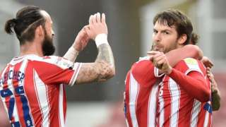 Nick Powell (right) celebrates scoring for Stoke City against Luton Town