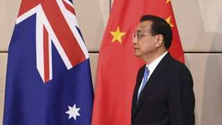 Chinese Premier Li Keqiang stands in front of Chinese and Australian flags at the Asean summit earlier this week