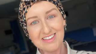 Donna-Marie Cullen pictured smiling, looking towards the camera and wearing a head scarf