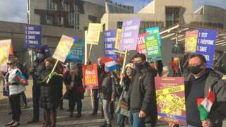 Travel industry protesters outside the Scottish Parliament