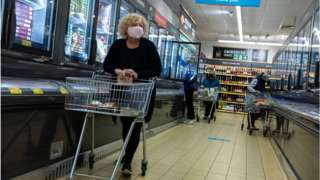 A woman shopping in a face mask