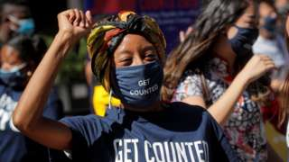 A woman in a Get Counted facemask at a promotional event for the US census in Times Square, New York, in September 2020