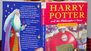 back and front cover of a copy of Harry Potter and the Philosopher's Stone
