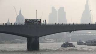 File image from 10 April 2015 of London's Waterloo Bridge, with St Paul's Cathedral visible through smog in the background