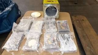 Cocaine found in over 1,700 tins of wall filler after German authorities seized more than 16 tonnes of cocaine in the northern port city of Hamburg, 24 February 2021