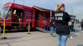 Health worker in a 'Grab a Jab' T-shirt by Boro vaccination bus