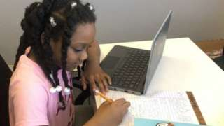 Kellyse Brown, 9, works at her desk