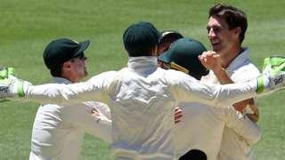 Australia celebrate beating India