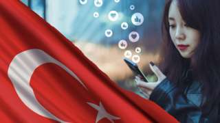 Composite of flag and young woman with mobile phone in her hand