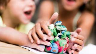 Children play with modelling clay