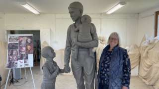 Sculptor Moira Purver with lifesize clay model for the statue of Trevor Chadwick