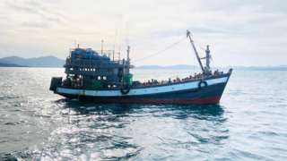 A boat carrying suspected ethnic Rohingya migrants is seen detained in Malaysian territorial waters, in Langkawi, Malaysia April 5, 2020