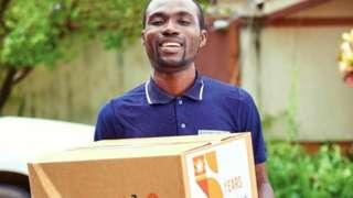 A Jumia delivery person with a box