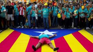 Catalans turn out on the streets of Barcelona in support of independence on their national day, known as the Diada