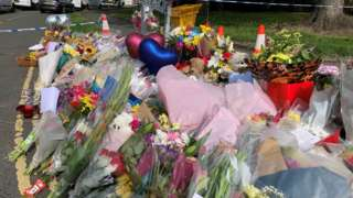 Tributes on road