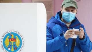 Voter at polling station