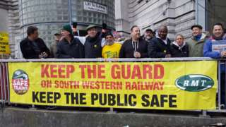 Workers on the picket line at Waterloo Station