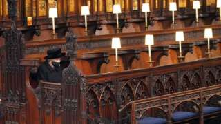 The Queen sits alone at St George's Chapel