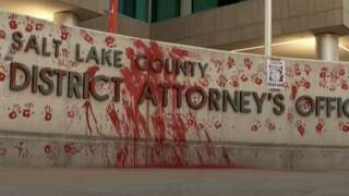 the district attorney's office sign with red paint on it