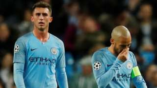 Manchester City's players react after losing to Lyon in the Champions League