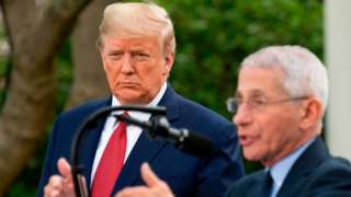 US President Donald Trump listens as Dr Anthony Fauci speaks during a Coronavirus Task Force press briefing in Washington, DC, 29 March 2020