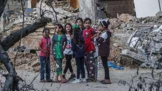 Palestinian girls play in rubble in Beit Hanoun, northern Gaza