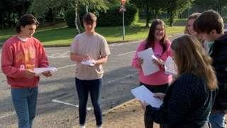 Students collect their grades at Ysgol Bro Myrddin in Carmarthen