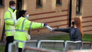 NHS staff hand out test kits to Glasgow University students
