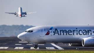 An American Airlines flight taxis to the runway prior to departing Ronald Reagan Washington National Airport in Arlington, Virginia, USA, 04 May 2021.