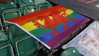 A Welsh flag with rainbow colours