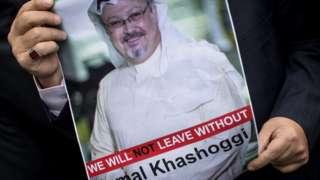 A man holds a poster of Saudi journalist Jamal Khashoggi