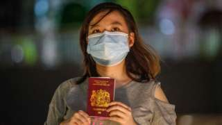 A woman in Hong Kong holding a British National Overseas passport.