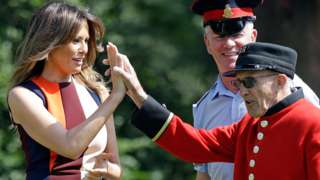 Mrs Trump high-fives a Chelsea Pensioner