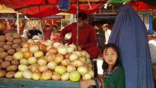 Afghans shop for food in a Kabul bazaar.