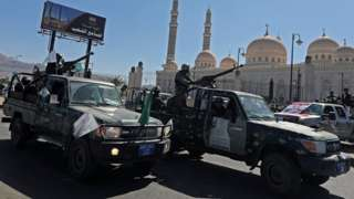 Police patrol trucks during the funeral of Houthi fighters, in Sanaa, Yemen (22 September 2020)