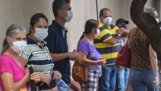 Residents line up to receive the Coronavac vaccine against COVID-19, in Serrana