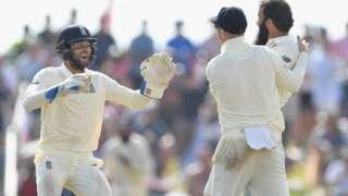 Moeen Ali and England wicketkeeper Ben Foakes Joe Root celebrate