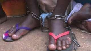Shackled feet