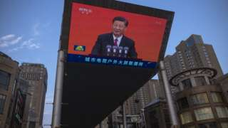Chinese President Xi Jinping is seen on a big screen showing the Chinese state television CCTV evening news as the city gets ready for the upcoming centenary of the Communist Party of China on June 30, 2021 in Beijing, China.