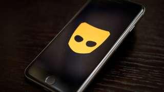 Grindr logo on phone