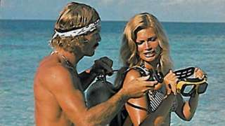 Couple featured on brochure advertising the diving resort