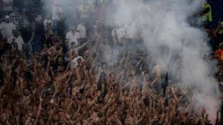 """Lazio""""s fans cheer during the Italian Serie A football match Lazio vs Napoli at the Olympic Stadium in Rome on 18 August 2018."""