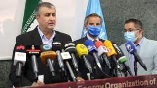 Director general of the International Atomic Energy Agency (IAEA), Rafael Mariano Grossi (C) and Vice president and Chief of the Atomic Energy Organization of Iran (AEOI), Mohammad Eslami (L) give a joint press conference in Tehran, Iran on September 12, 2021