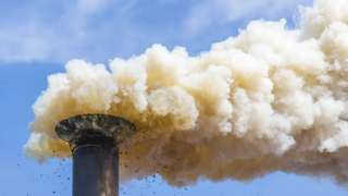 A chimney releasing CO2