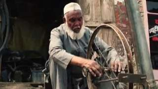 Mohammad Shareef repairing a cycle wheel