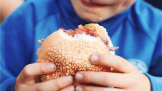 A child eating a burger