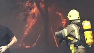 Firefighters attend the fire