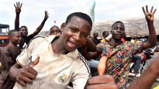 People celebrate the re-election of All Progressive Congress (APC) presidential candidate, President Muhammadu Buhari, in Abuja, Nigeria, 27 February 2019